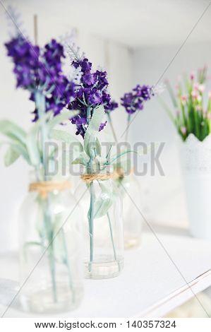 beautiful purple flowers in the glass bottle