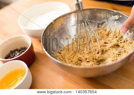 Mixing batter inside bowl