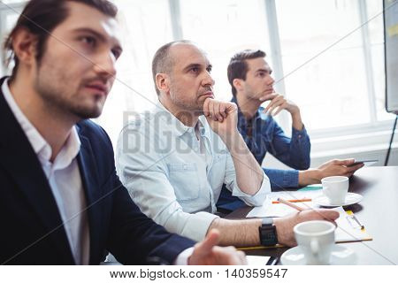 Thoughtful business people during meeting at creative office