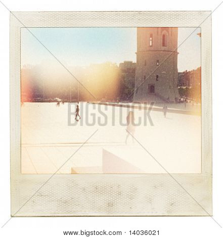 Designed old instant photo. Used my own photo taken in cathedral square, Vilnius, Lithuania with film camera. Grain, blur, light leak added as vintage effect.