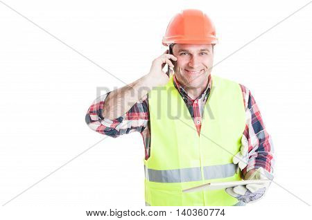 Handsome Builder Holding Tablet And Calling Somebody