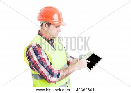 Male Constructor Pointing Finger On Tablet