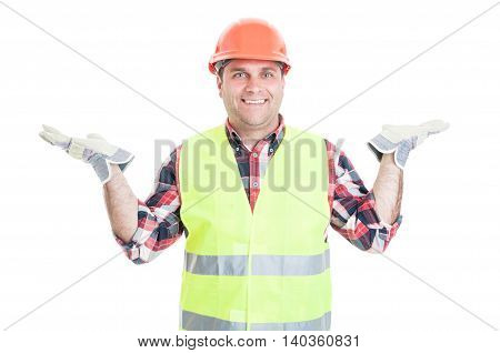 Joyful Young Builder Holding Something In His Palms