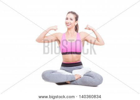 Young Female Sitting With Legs Crossed Showing Biceps