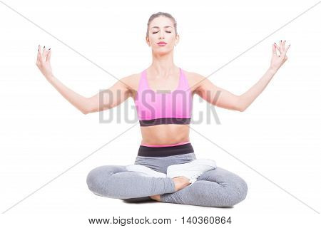 Fit Girl Sitting In Yoga Position And Meditating