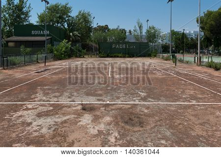 Abandoned or deserted tennis court with blue sky