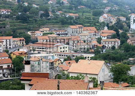Beautiful city landscape in style of traditional Italian architecture. Amalfi Coast, Italy. Houses with roofs of red tile.