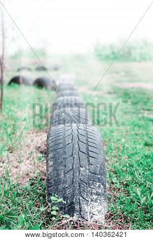 Machine used tire half buried in the ground