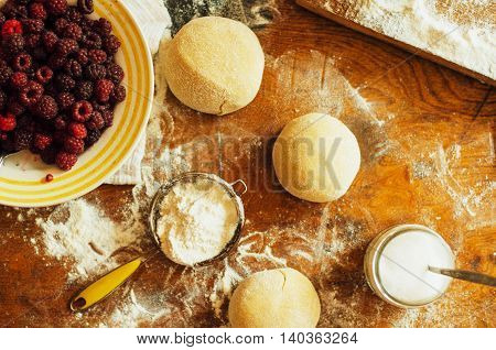 Cooking Homemade Raspberries  Cake.  Woman Rolling A Pie Dough