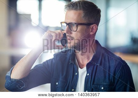 Man talking on phone in creative office
