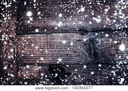 Christmas wooden background with snow flakes. Brown wood texture with white snow - View with copy space