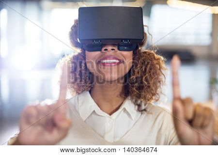 Woman wearing virtual reality glass in office