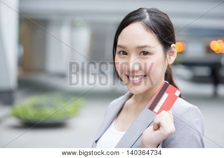 businesswoman take a credit card and go shopping in hon kong asian