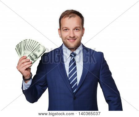Portrait of a good-looking man showing a lot of dollars against white background