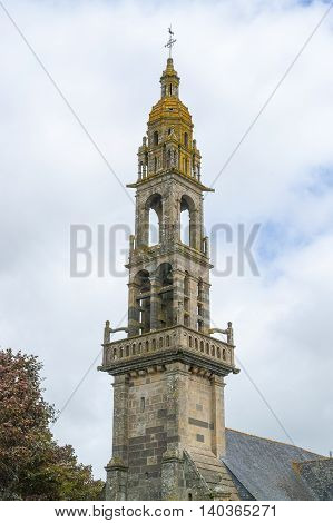 steeple of a church located in a commune in the Finistere department named Rumengol at Le Faou in Brittany