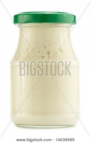 Glass jar of horseradish, isolated