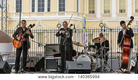 St. Petersburg, Russia - 23 July, Musicians with instruments on the stage, 23 July, 2016. Speech by David Goloschekin with his jazz group on the Arts Square in St. Petersburg.
