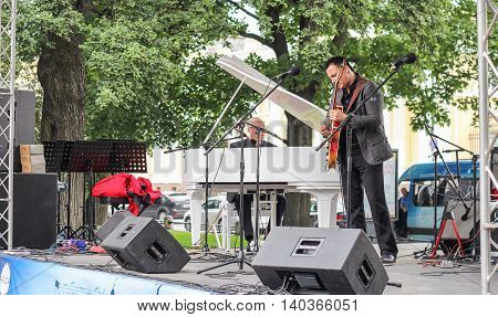 St. Petersburg, Russia - 23 July, Musicians under the trees, 23 July, 2016. Speech by David Goloschekin with his jazz group on the Arts Square in St. Petersburg.