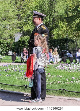 St. Petersburg, Russia - 9 May, Naval officer and daughter, 9 May, 2016. Vacationers people on the lawns and gardens in the city.