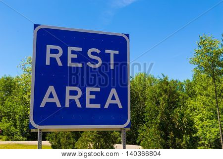 A blue and white Rest Area Sign.