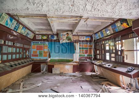CHERNOBYL, UKRAINE-MAY,20: technical room with survived colorful signboards and furniture on May 20, 2016 in Pripyat