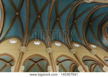 high beige columns and vaulted blue ceiling in the Christian church