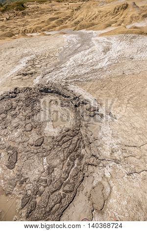 Small crater of a mud volcano, outdoor shot