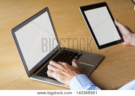 Cropped image of man working on laptop in creative office