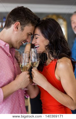 Couple having glass of champagne in restaurant