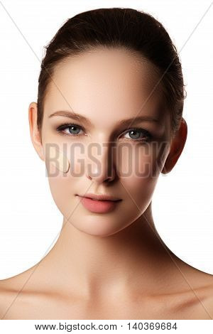 Beautiful Face Of Young Woman With Cosmetic Foundation On A Skin