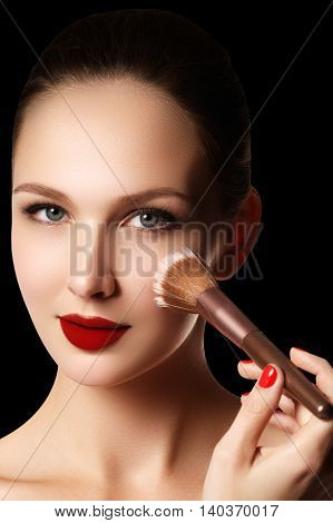Make-up And Cosmetics. Beauty Woman Face Isolated On Black Backg