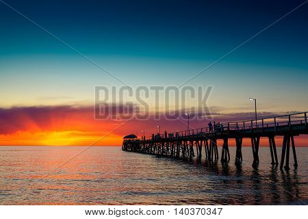 People relaxing on the Henley Beach Jetty at sunset South Australia
