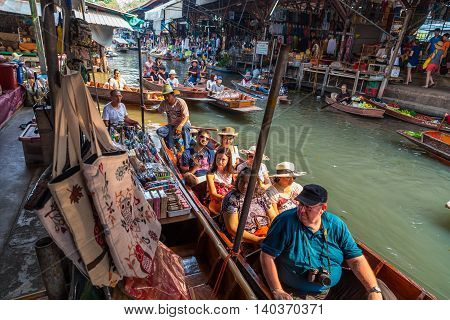 RATCHABURI THAILAND-MARCH 20: Damnoen Saduak Floating Market on March 202016 in Thailand. Having many small boats laden with Souvenir shop colourful fruits vegetables and Thai cuisine.