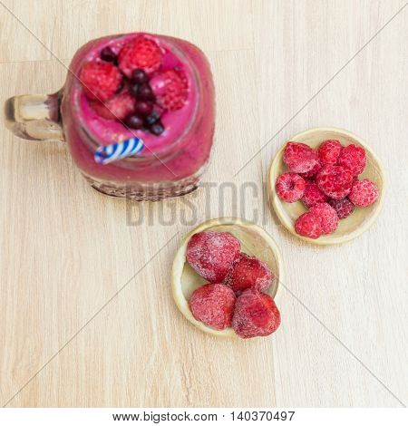 Jar Of Smoothies With Strawberries Rasberry And Blueberry On Wooden Table