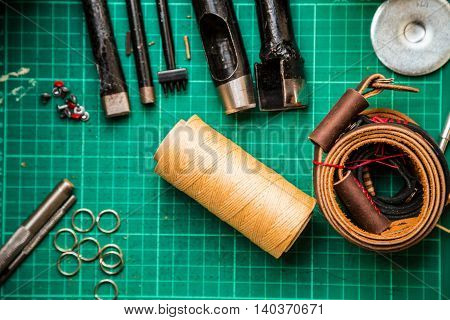 Leather Crafting Tools Make Camera Strap Still Life On Green Work Space Board