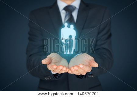 Family and life insurance concepts. Businessman with protective gesture and silhouette representing young family.
