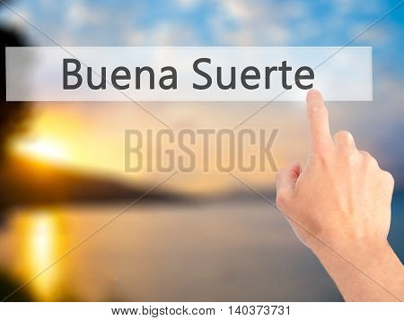 Buena Suerte ( Good Luck In Spanish) - Hand Pressing A Button On Blurred Background Concept On Visua