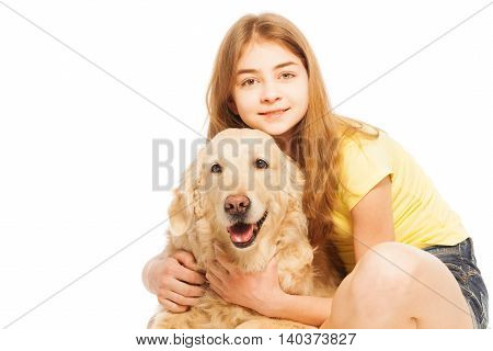 Close-up portrait of beautiful teenage girl hugging her Golden Retriever doggy, isolated on white background