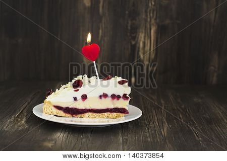 Birthday or Valentines day cake with cowberry and white chocolate. Selective focus