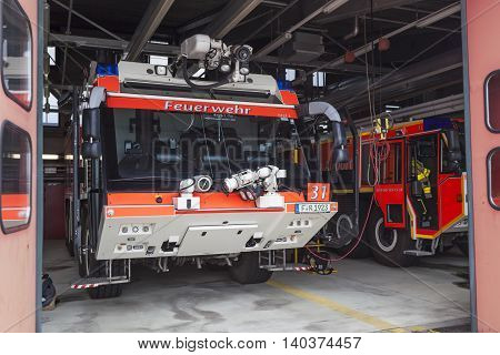 FRANKFURT GERMANY - JULY 24 2016: Modern fire trucks at the airport Fire Department in Frankfurt Main International Airport