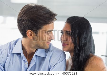 Romantic couple looking at each other in cafe