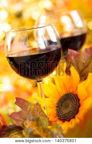 Autumn arrangement with wine sunflowers and pumpkins.