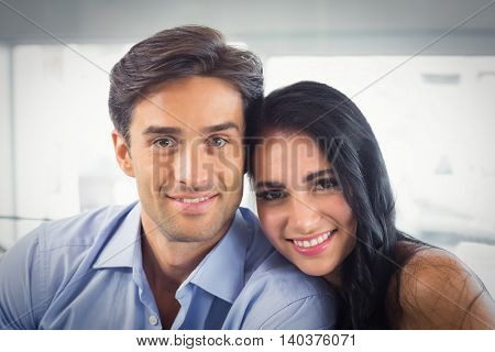 Portrait of smiling couple in cafe