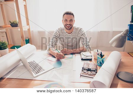 Happy Smiling Man Drawing Plan Of Building On Blueprint