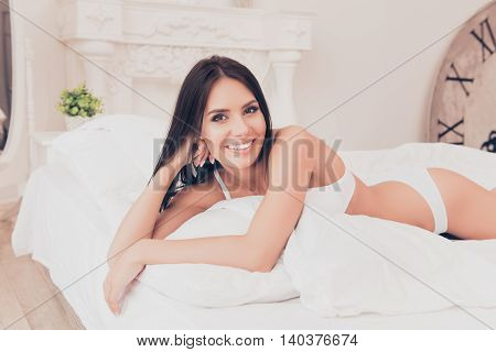 Attractive Sexy Smiling Woman Lying In Bed And Resting
