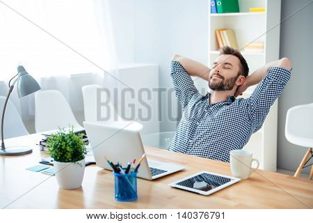 Young Worker Having Break And Resting After Solving Task