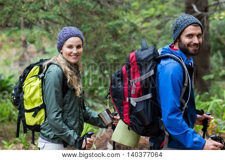 Portrait of happy hiker couple hiking at countryside