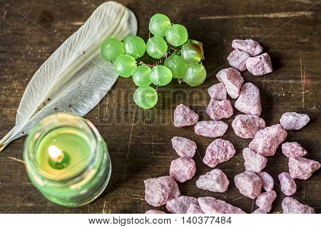 Candle lilium and stones on wooden table