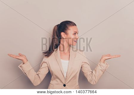 Young Happy Businesswoman Gesturing With Hands And Showing Balance