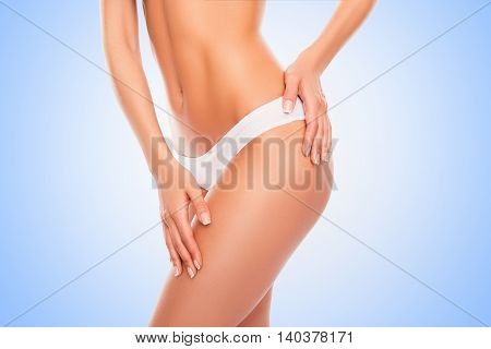 Beautiful Slim Woman Body Isolated On Blue Background